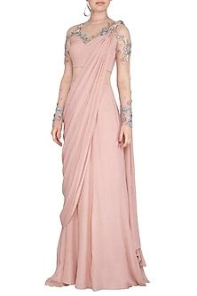 Featuring a pearl pink saree gown in crepe and tulle base with golden kasab, wheat pearl, sequins, fine bugle beads and multi colored silk thread floral embroidery. FIT: Fitted at bust. CARE: Dry clean only. Stylish Sarees, Stylish Dresses, Elegant Dresses, Indian Wedding Outfits, Indian Outfits, Indian Dresses, Dress Outfits, Fashion Dresses, Party Outfits