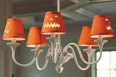 This Halloween, show off your sense of humor by replacing your everyday chandelier shades with these jack-'o-lantern ones.