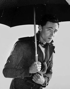 I am loving these pictures of him under an umbrella