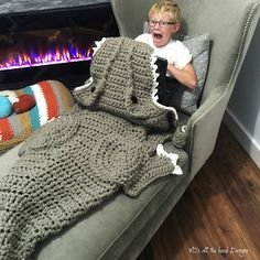 This is a PDF crochet pattern for a Bulky T-Rex Blanket! This is one of the most requested designs I've had since the shark blanket went viral!