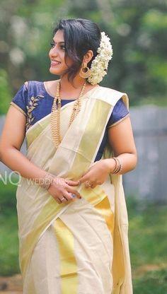 Rajan Wahi's media content and analytics Kerala Saree Blouse Designs, Saree Blouse Neck Designs, Half Saree Designs, Onam Saree, Kasavu Saree, Kerala Traditional Saree, Set Saree, Saree Hairstyles, Indian Beauty Saree
