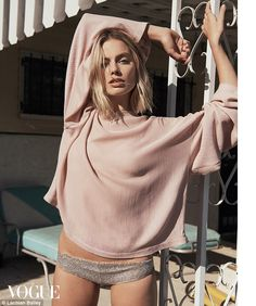 Margot Robbie smolders in the new issue of Vouge Australia, where she displays her thin figure in an itty bitty pair of boy shorts and a petal pink blouse