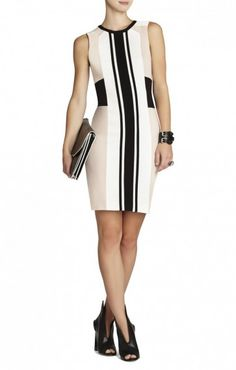$178.00 A flattering silhouette and modern color-blocking make this a must-have for chic work or social events. Round neck. Sleeveless.Color-blocked pattern. Contrast stripes at center front.Contrast blocking detail at neckline and waist.Exposed center back zipper closure.Crepe: 92% Polyester, 8% Spandex.Dry Clean.Imported