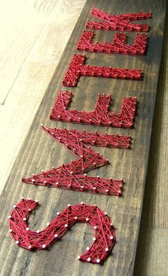 Nine Red: String Art  We could do this for extended worship but use rubberbands and spell out the word GROW, much larger scale. As you stretch your rubber band reflect on the Lords stretching and growing you into something better.... I dont  know.