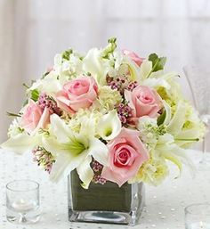 Pink roses, white mini calla lilies, white hydrangea and more, in a modern glass cube vase.