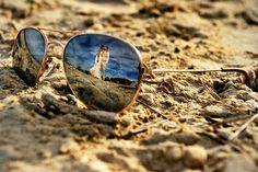 Oh to have creative wedding photos :: beach wedding photo in reflection of aviators