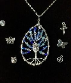 Oval Swarovski Crystal Tree of Life with charm of your choice in color of your choice.