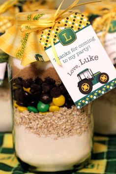 John Deere party favors - jars of cookie mix in John Deere colors (I love this idea except it would be Cat in the Hat themed...)