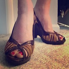 Fun Aldo Platforms! Fun going out shoes!!!! Brown tones, mixed faux animal (crocodile and zebra) Aldo platforms. Skid pads on bottom of show heel height 4inches. Only worn once in doors as evident in picture of the soles. ALDO Shoes Platforms