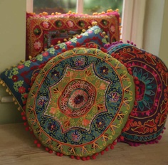 ethicalsuperstore.com round crewel work cushion, £26.95