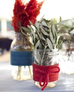 HERB CENTERPIECE  A variety of different herbs and flowers are placed in Mason jars wrapped with yarn.