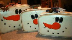 snowman suitcases....these would be cute for storing ornaments and such