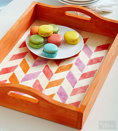 These DIY serving trays are the perfect accent to place on your coffee table or use when you are entertaining guests! Make a serving tray a little more unique by painting stripes on it, staining the wood a fun color, stenciling a metal serving tray or decoupaging it with vintage newspapers and ads.