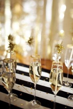 sugar on rim and sparkly things for drink stirrers...A way to bring the sparklers back into an indoor reception.  But we could definitely class it up a bit.