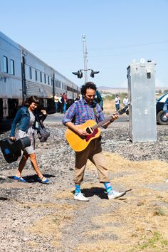 Jade Castrinos from Edward Sharpe & the Magnetic Zeros coming off the train. From http://www.bigeasyexpress.com  Photo by Julie Ling