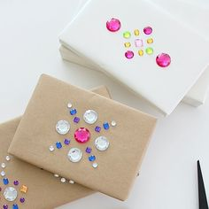 Use rhinestones to create pretty designs on top of gifts