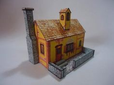 Medieval Style House Paper Model - by Papermau - The Model Assembled     ===         Here is the Medieval Style House Paper Model, assembled. It is a really little model, what I call desktop model, measuring 6,5 cm tall, 7,0 cm width and 5,5 cm depth. I used 180 gr paper to build it, but I think 100 gr will be better to make the folds. For those who want to build it, the link in at the end of this post.