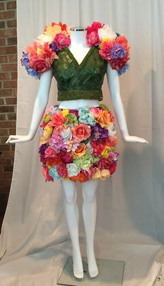 """Flower Dress - Miss Olivia Spring - by Legare at A Ribbon Runs Through it -  Spring Flower Dress  -mini skirt with hand woven """"grass"""" crop top and matching flower bolero! Roses, hydrangeas, peonies and more! Bright and fun! #flowerdress #mannequin #flowers #spring #roses #display #roses #hydrangeas #peonies"""