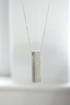 Polished Concrete Necklace DIY - Learn How to Make a Minimalist and Modern Concrete Necklace in this jewelry  tutorial. You will need cement, cardstock..