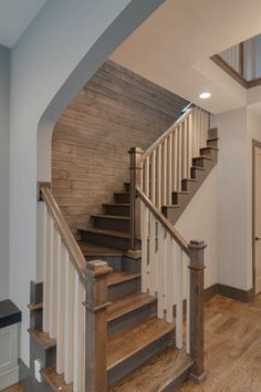 The New Craftsman contemporary staircase and planked wall.