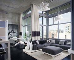 Big windows, minimalist furniture, lots of light and lack of color. LOVE.