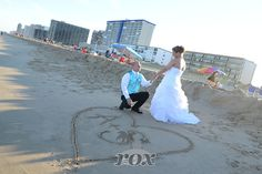 Ocean City Maryland groom on one knee re-enacts beach wedding wedding proposal: https://www.roxbeachweddings.com/