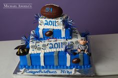 Stacked Sheetcakes #38Graduation  This cake is unique because it is made up of four tiers but they are similar to sheetcakes. It's a great way to add height with less amount of servings. The entire cake is iced in buttercream and each layer is decorated differently with stripes and swirls. The football and band member are both made from gum paste and make great accents. The colors can match any school.