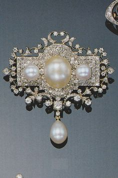 Cartouche design pearl and diamond brooch, circa 1900.