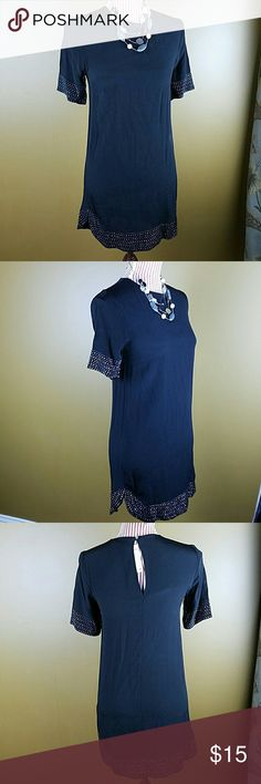 Black Dress Cute black short sleeved dress with sparkle details on the sleeves and around the bottom. Small slits on both sides of the dress. Slight sheer at the bottom. Can also be worn as tunic. Tried on, but never worn. Bust: 16, Length: 28 inches. 100% Viscose. H&M Dresses