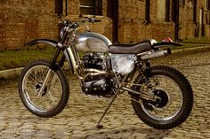 Atom Bomb custom vintage-themed dirt bike based around a 1974 Triumph Bonneville motor.