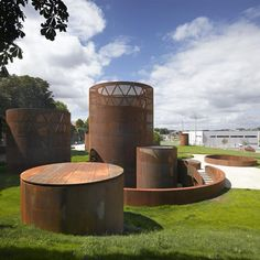 In Spain, Corten steel towers that emerge from the lawn above an underground museum in Lugo