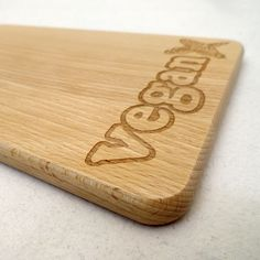 Cutting board with 'vegan cross', made of beechwood. You can order it from our vegan online store www.rootsofcompassion.org.