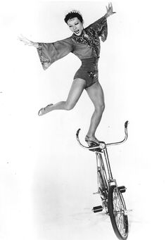 Ballerina On The Golden Bicycle