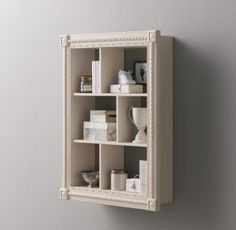 RH baby&child's Hand-Carved Display Shelf:Graced with intricate detailing, our extra-large display shelf has several openings to prop small books, stuffed animals and other tiny treasures. The open design makes it easy to create a revolving display of childhood curios.