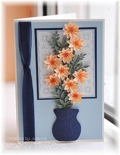 Framed Lace and Apricot Flowers. The flowers are made using two layers of a five petal flower shape, with a mini daisy center.