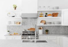 modern approach to using classics: marble surfaces, white cabinets & stainless appliances