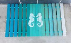 It's summer, after all, so why not bring a bit of the beach to your front door. Create a wooden mat using slats cut to size, give it an ombre makeover, and then add a cute nautical image, like shells or seahorses, for a fun summertime look.