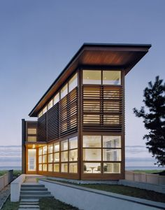 Sound House / Roger Ferris + Partners - This waterfront home on an unusually narrow site takes advantage of spectacular views while preserving privacy from adjacent properties. The loft-like interior spaces open to glass curtain walls at each end. Screened side walls provide visual separation from neighbors