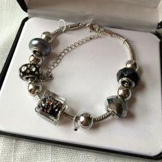Glitzy Rocks Charm Bracelet New Original retail price is $149.99. Beautiful bracelet. Glitzy Rocks Jewelry Bracelets