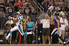 BALTIMORE, MD - AUGUST 22: Ted Ginn #19 of the Carolina Panthers returns a punt for a first quarter touchdown in front of punter Sam Koch #4 of the Baltimore Ravens during a preseason game at M Bank Stadium on August 22, 2013 in Baltimore, Maryland. (Photo by Rob Carr/Getty Images)