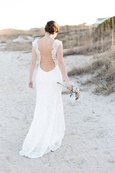 "Watters' gracefully sculpted ""Viv"" gown features baroque lace and a plunging illusion back. 