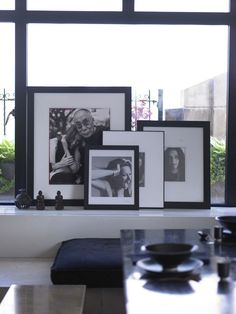 I've always found it interesting to see art or photographs layered when  they are just propped up on a mantel. Or furniture. Or on a shelf or ledge.  it's such a cool effect!