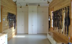 Tack room by Fuog/Interbuild.  Really like the bench beneath the bridle racks