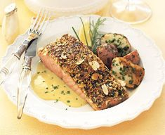 Almond-crusted Salmon with Leek and Lemon cream.  love nut-crusted fish dishes