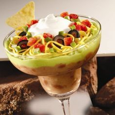Refried beans, guacamole, zesty tomatoes, cheese, onions and sour cream layered and served in individual stemmed glasses