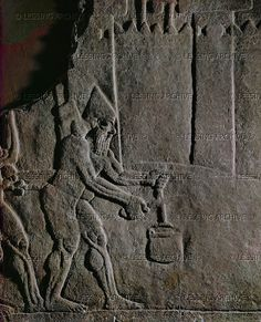 ASSUR RELIEF 10TH-6TH BCE Assyrian soldiers cut the rope to a pail for a well in the besieged city. Detail from Ashurnazirpals siege of a city. Stone bas-relief (9th BCE) from the palace of Ashurnazirpal II in Nimrud, Mesopotamia. WA 124530 British Museum, London, Great Britain