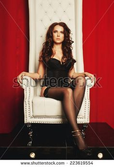 sensual princess woman in black lingerie sitting on throne