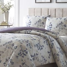 This beautiful floral print features a soft ivory ground with blue and purple flowers in a watercolor floral print. The bedding reverses to a soft purple ground. Made of soft 100-percent cotton sateen.