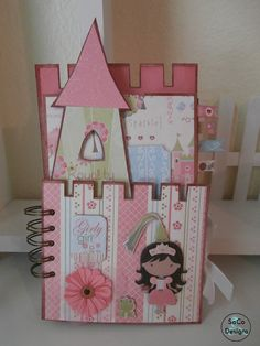Heres a cute castle album to house your little princess precious photos. Made with chipboard and envelopes. Album can feature 25 photos and many more