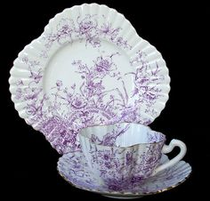 A rarely found Basket of Flowers patterned tea trio (cup, saucer and  plate) in mauve colourway by Wileman & Co., The Foley China, predecessors of Shelley, in their squared & fluted 'Alexandra' shape dating from the period 1890 to 1910.